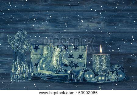 Dark Blue Christmas Decoration With Candle And Presents On Wooden Background.