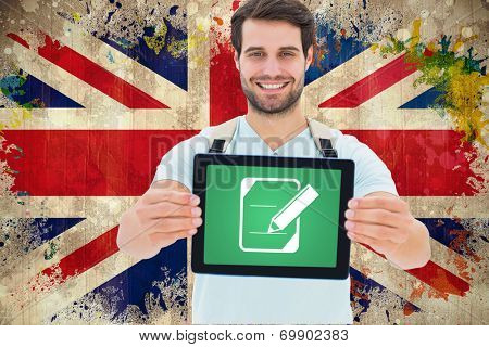 Student showing tablet against grunge union jack flag