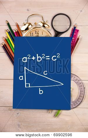 Trigonometry against students desk with blue page