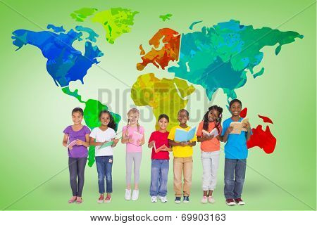 Elementary pupils reading books against green vignette with world map