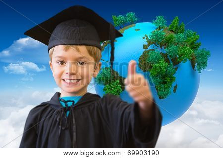 Cute pupil in graduation robe against bright blue sky with clouds with globe