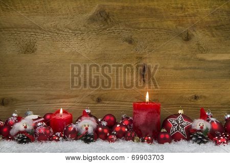 Merry Christmas: Classic Christmas Decoration In Red And White With Two Candles On Wooden Background