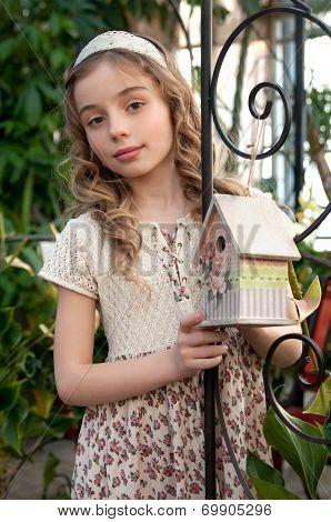 Beautifull Girl With Nesting Box