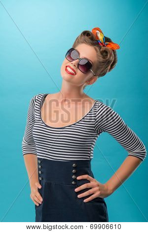 Beautiful girl with pretty smile in pinup style posing