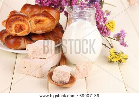 Dry yeast with pastry on wooden table close-up