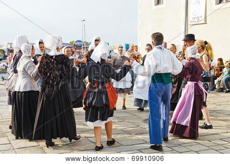 Amateurs In National Costumes Dancing Folk Dance