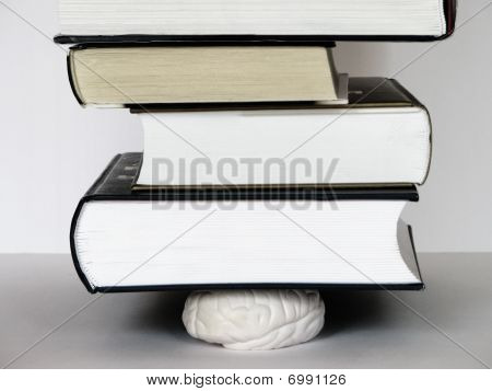 Brain Squeezed By Tower Of Books