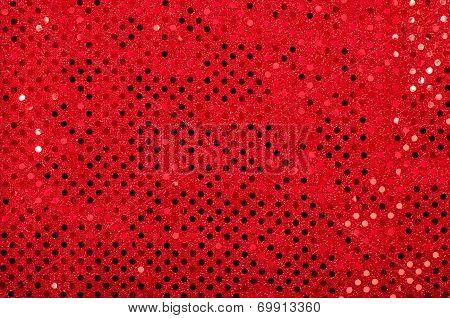 Red sequins pattern. Sparkling sequins background.