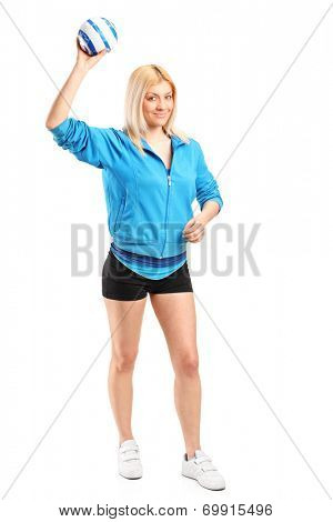 Full length portrait of a professional female handball player posing isolated on white background
