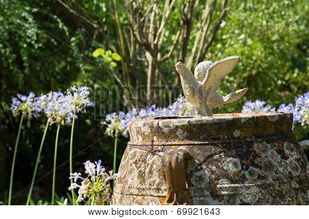 Garden Decoration With A Pigeon In The British Cemetery In Corfu. Metaphor For Holy Spirit.