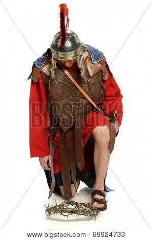 Roman soldier kneeling in front of crown of thorns over white background