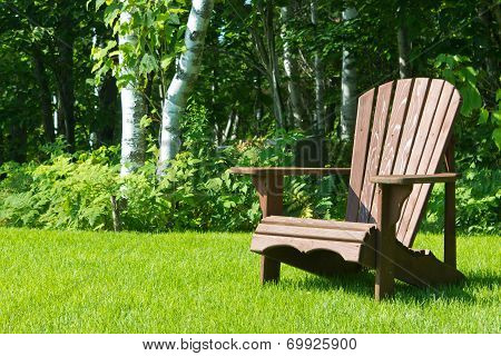 Wooden Summer Lawn Chair Outside On The Green Grass