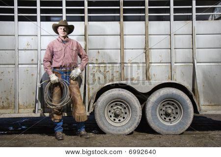 Man Wearing Cowboy Hat Holding Lariat