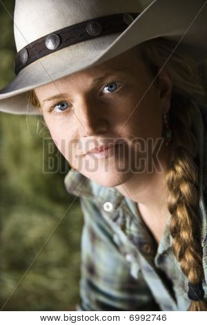 Attractive Young Woman Wearing A Cowboy Hat