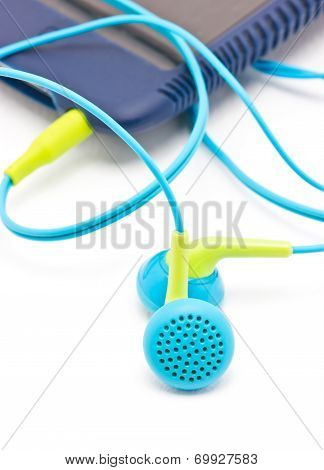 Colorful Earphones With Portable Mp3 Player Isolated On White Background.