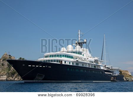Gigantic Big And Large Luxury Yacht With Sail Boat And Helicopter Landing Place On Bord.