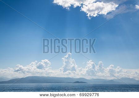 Blue Bright Sky Background On The Ocean With Clouds