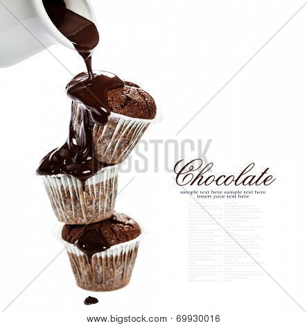 muffins with chocolate sauce over white