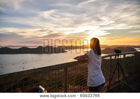 back portrait of girl looking to sunset
