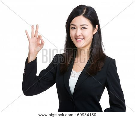 Asian businesswoman with ok sign