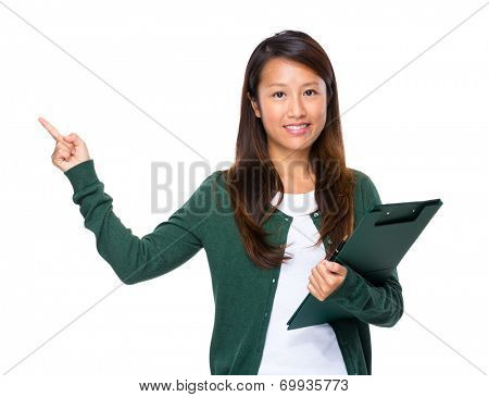 Singaporean woman with clipboard and finger up