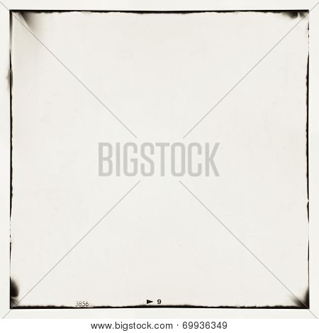 medium format film frame background. Texture contains grain, dust and light leaks