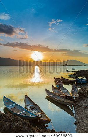 small boats in the coastal lagoon in the sunrise at Ninh Thuan Vietnam