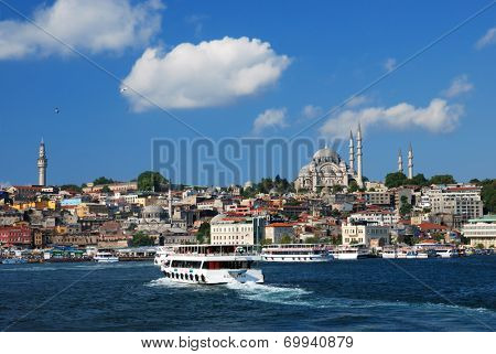 ISTANBUL, TURKEY - AUGUST 7, 2007: Ferry boats traverse the Golden Horn bay. The ferry is the fastest and cheapest way to traverse Bosporus strait
