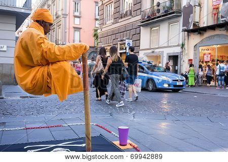 Street Performer In Naples, Italy. Every Day, Street Performers Try Their Hand At Making A Living Fr