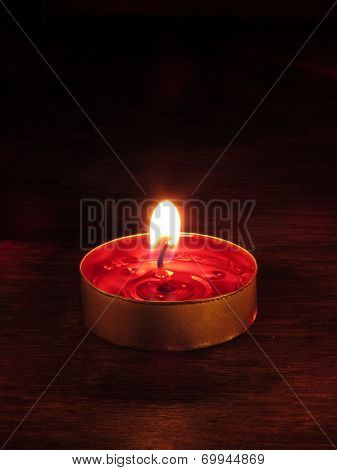 Single Candle Burning in Dark