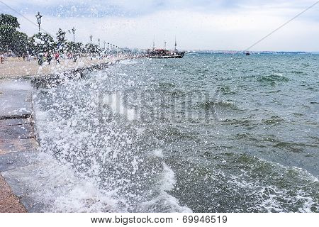 Gushing Surf Of A Wave Smashing Against Seaport At Thessaloniki, Greece