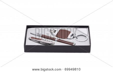 Pen and trinket in a box.