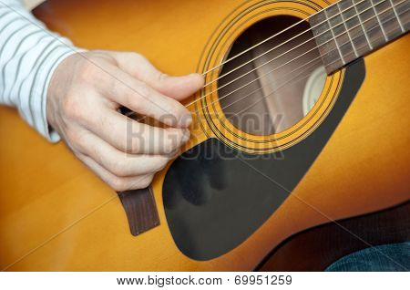 A Man Plays The Six String Guitar