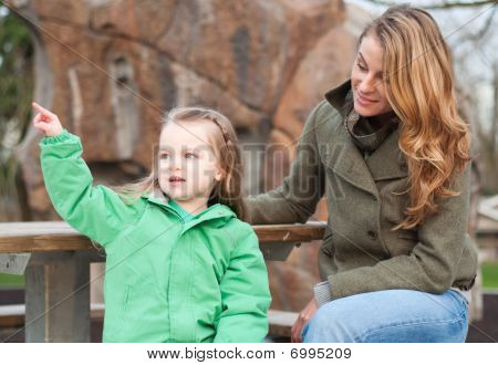 Little Girl Storytelling To Her Mom