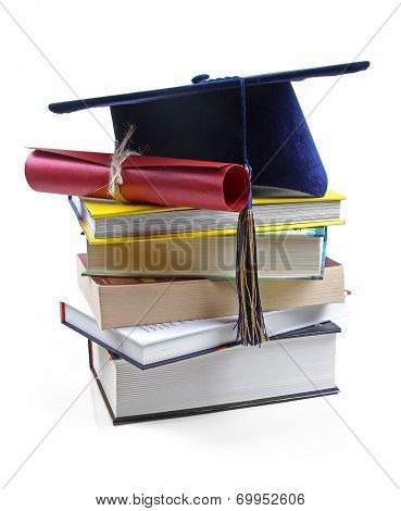 Graduation Hat And Diploma On Stack Of Books
