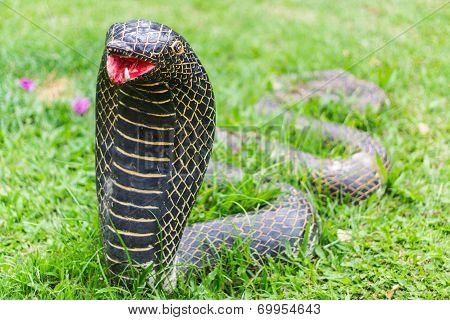 The Statue Of The Snake In Garden
