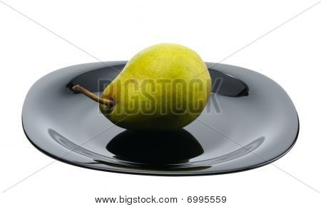 Pear On A Black Platte, Isolated