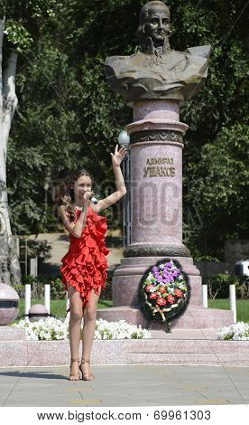 Beautiful Girl Singing At The Celebration Of The Navy At The Monument To Admiral Ushakov