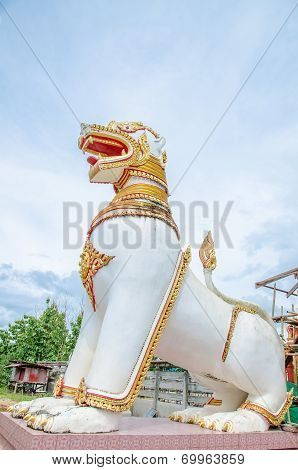 White Lion Statue In Front Of The Temple