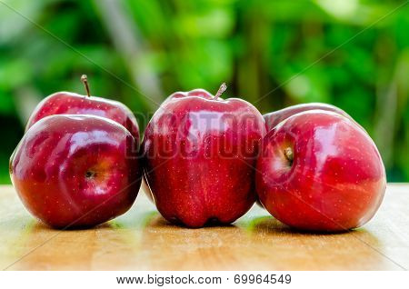 Red Apple On Wood Table