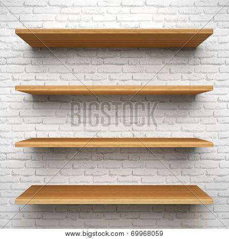 Empty wood shelves on white brick background.