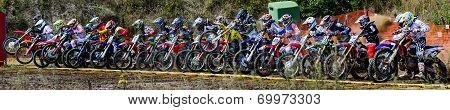 Motocross Riders At Start Line