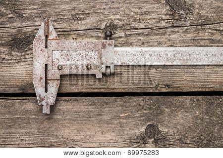Close Up Image Of Old  Vernier Caliper On Wood Background