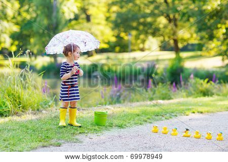 Adorable Little Child In Yellow Rain Boots And Umbrella In Summer Park