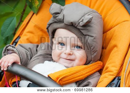 Adorable Baby Boy In Warm Winter Clothes In Stroller