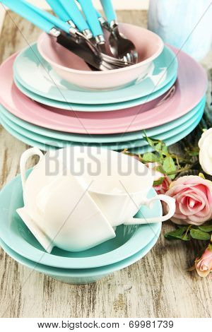 Lots beautiful dishes on wooden table close-up