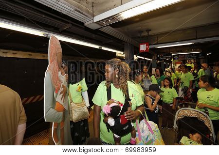 Moms awaiting subway car Chambers Street