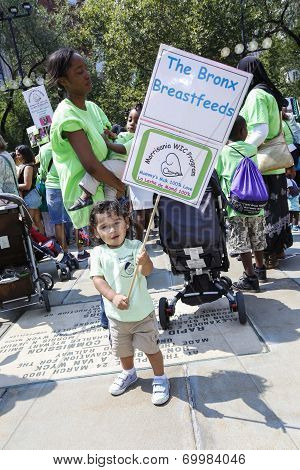 Toddler with breastfeeding sign