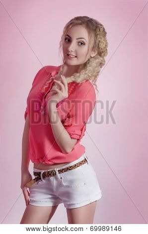 Fashionable young girl in with makeup in fashion clothes