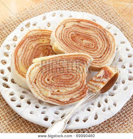 Brazilian Dessert Bolo De Rolo (swiss Roll, Roll Cake) On White Plate
